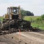 1. Enlèvement du sol arable pour un chemin